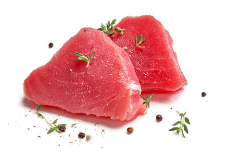 Two slice of raw tuna meat with thyme herbs and spices isolated on white background. 版權商用圖片