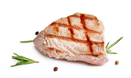 Grilled tuna steak with rosemary and spices isolated on white