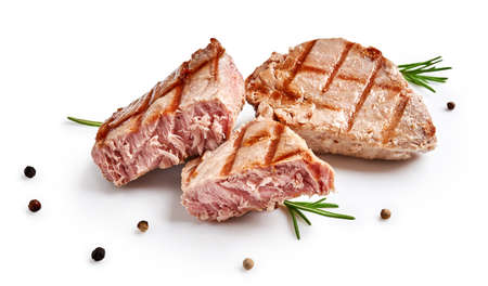 Two grilled tuna steak with rosemary and spices isolated on white. Tuna fish slices with herbs. 版權商用圖片