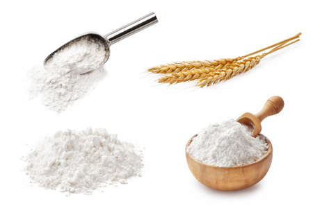 Set of wheat flour isolated on white background. Wheat spikelets and flour in wooden bowl and spoon