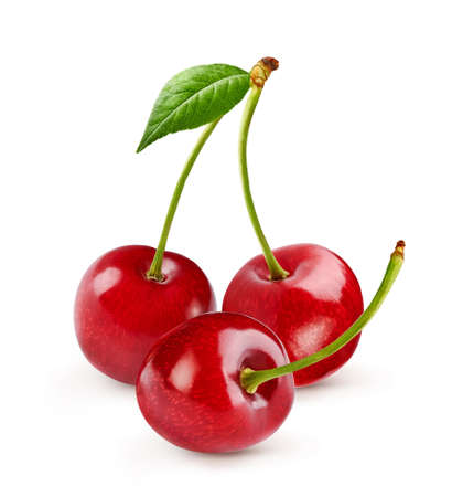 Three cherries with cherry leaf isolated on white. Foto de archivo