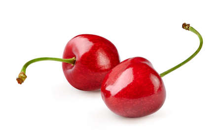 Two cherries with cherry leaf isolated on white.