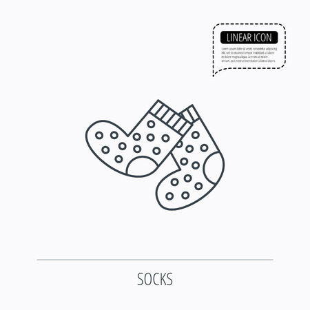 baby underwear: Socks icon. Baby underwear sign. Clothes symbol. Linear outline icon. Speech bubble of dotted line. Vector