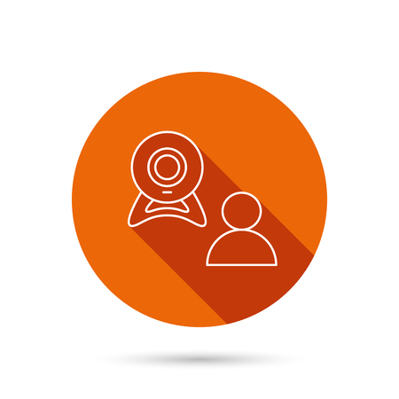 web conference: Video chat icon. Webcam chatting sign. Web conference symbol. Round orange web button with shadow.