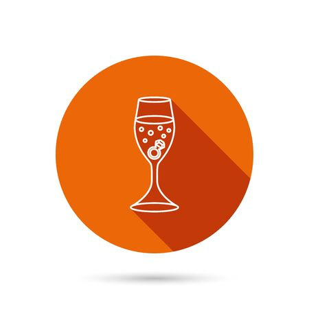 web engagement: Glass with ring icon. Engagement symbol. Round orange web button with shadow.