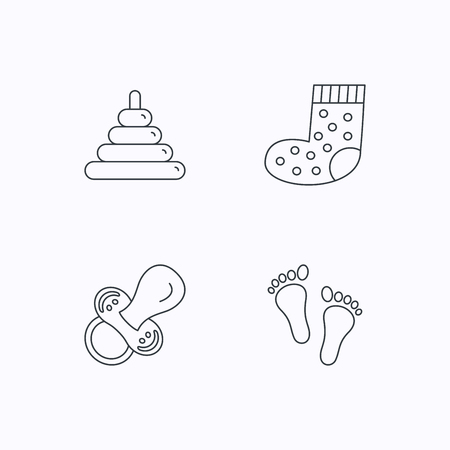white socks: Footprint, pacifier and socks icons. Pyramid toy linear sign. Flat linear icons on white background. Vector Illustration