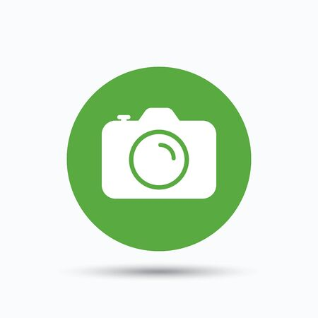 photocamera: Camera icon. Professional photocamera symbol. Flat web button with icon on white background. Green round pressbutton with shadow. Vector