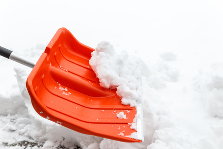 Winter shoveling. Removing snow after blizzard. Shovel which cleaning snow. Stock Photo
