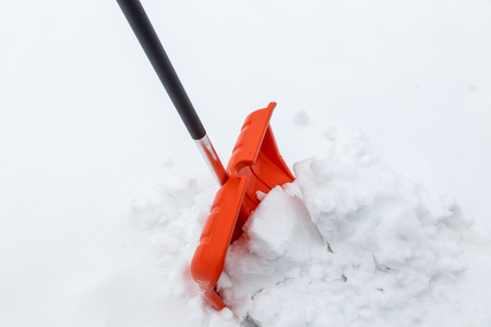 shoveling: Winter shoveling. Removing snow after blizzard. Shovel which cleaning snow. Stock Photo
