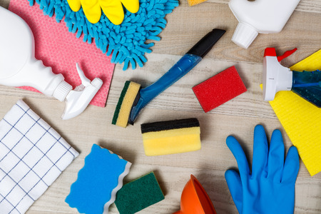House cleaning products. Sponges and chemicals bottles. Rubber gloves, towel and washcloth. Household equipment. Stock Photo