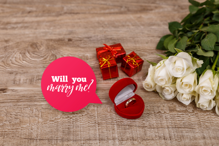 Roses with heart engagement box. Will you marry me design. Valentines day concept. Fresh natural flowers with gift boxes. Wooden rustic board. Stock Photo