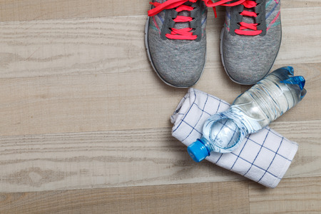 shoelace: Fitness gym equipment. Sneakers, water bottle with towel. Workout footwear. Sport trainers with pink shoelace.