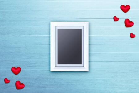 scraped: Blank photo frame with red satin hearts. Love design. On blue wood background. Painted scraped wooden planks texture or pattern.