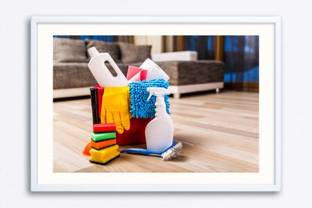 Cleaning service. Bucket with sponges, chemicals bottles and plunger. Rubber gloves and paper towel. Household equipment. Wall frame poster with cleaning equipment photo. Mockup template. 写真素材