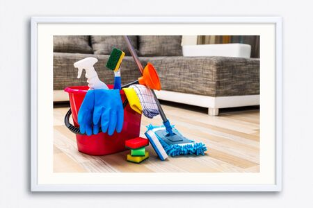 Cleaning service. Bucket with sponges, chemicals bottles and mopping stick. Rubber gloves, plunger and towel. Household equipment. Wall frame poster with cleaning equipment photo. Mockup template.