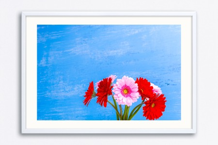Gerbera flowers in vase on blue wood vintage background. 8 march or Valentines day love design. Fresh natural flowers. Painted wooden planks. Wall frame poster with flowers photo. Mockup template.