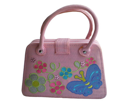 The handbag for the girl is pink colour with pastes and bright application.The handbag is isolated on a white background.