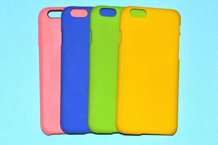 Colorful phone cases isolated on blue background Stockfoto