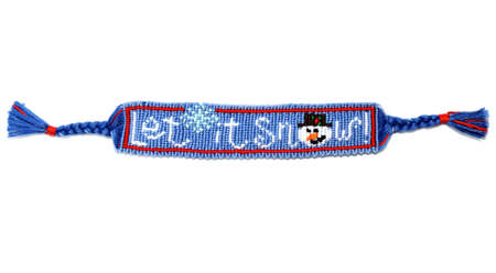 Woven friendship bracelet with Christmas alpha pattern Let it snow. Handmade of thread, isolated on white background. New Year DIY gift idea