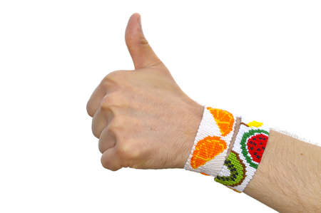 thumbs up gesture with friendship bracelets on wrist. isolated on white background