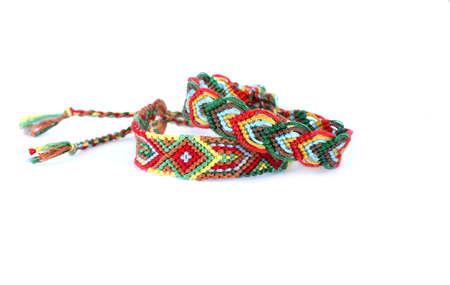 DIY friendship bracelets with Indian colorful pattern handmade of thread on white background Zdjęcie Seryjne