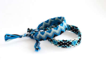 DIY woven tied friendship bracelets with unusual braiding. Summer accessory