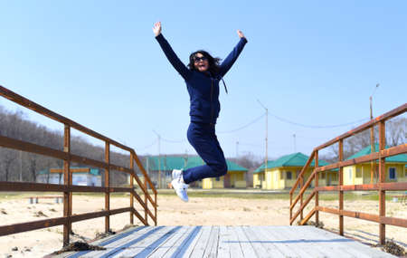 Cheerful 45 y.o. Russian woman jumping and laughing Zdjęcie Seryjne
