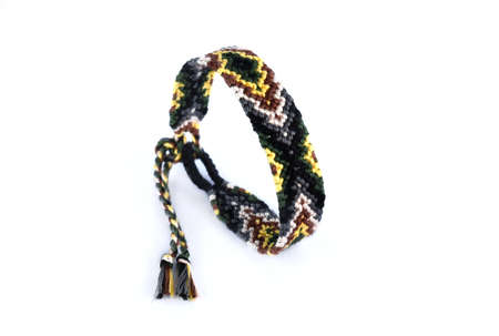 Woven friendship bracelet with bright colorful pattern handmade of thread isolated on white background