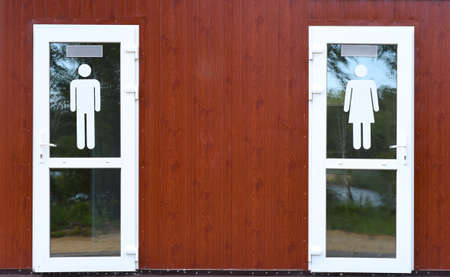 two doors with gender symbols male and female