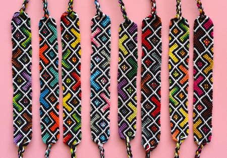 DIY woven friendship bracelets with abstract geometric pattern. Summer accessories Zdjęcie Seryjne