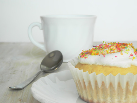 condensed: Sweet homemade condensed milk cupcakes and a cup of tea