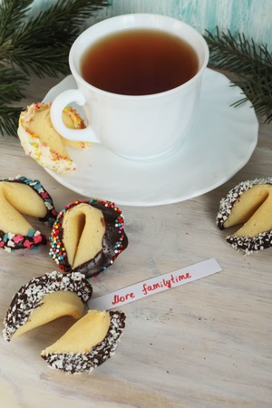 Fortune cookies and a cup of tea on the table more familytime