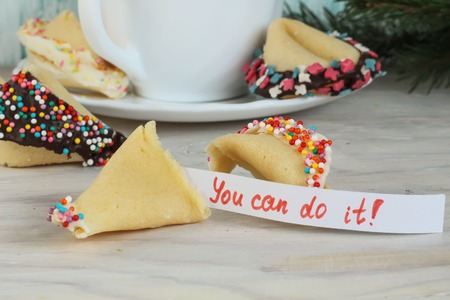 Fortune cookies with inscription you can do it and a cup of tea on the table Stock Photo