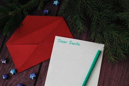 letter: Child letter to Santa Claus. Christmas decorations, red envelope