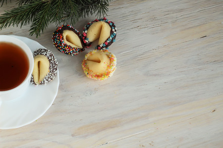 cup four: four decorated fortune cookies and a cup pf tea on wooden background Stock Photo