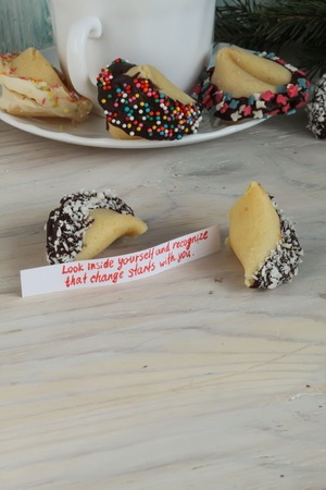 look inside: open Fortune cookie decorated with chocolate look inside yourself and recognize that change starts with you