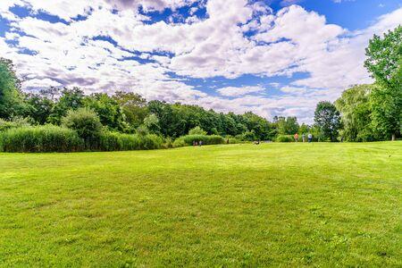 beautiful summer landscape with soft green grass trees Snug Harbor Cultural Center Botanical Garden Stock Photo