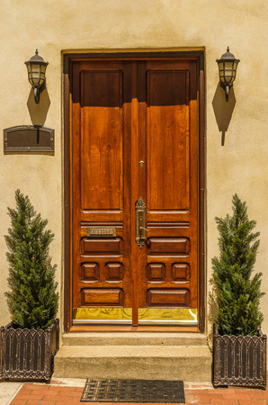 Double wooden doors and are flanked by twin light fixtures, Philadelphia