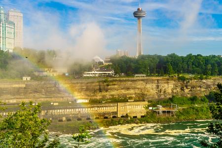 great danger: Rainbow to Canada over Niagara River, Niagara Falls, Ontario, Canada Stock Photo