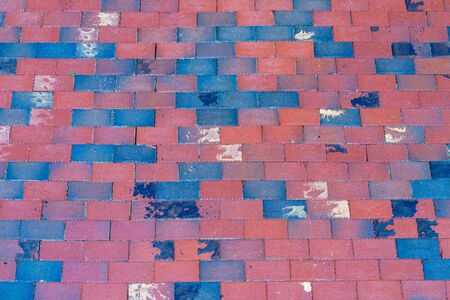 solid background: Old red and bkue brick pavement, texture