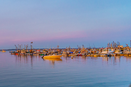 Ships and boats in the Provincetown Marina during sunset Provincetown, MA