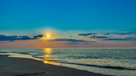 Sunset on the beach on north side of the Provincelands Cape Cod, Atlantic ocean view MA US Фото со стока