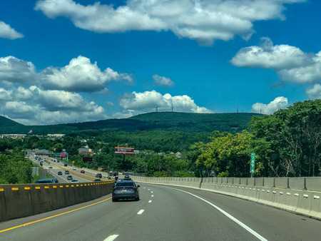 Highway among hills, forests and fields near Scranton, Pennsylvania US