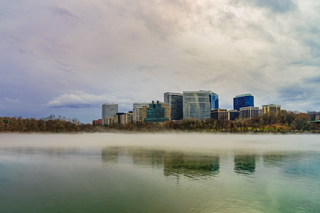 Rosslyn, Arlington, Virginia, USA city skyline on the Potomac River, winter fog on the water