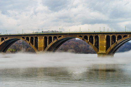 Francis Scott Key Bridge across Potomac River, winter fog on the water. Stock Photo