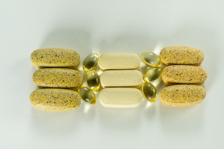 Vitamins, dietary supplements tablets, Fish oil capsules. Pharmacy, medicine and health concept.