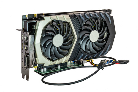 Graphics card for mining cryptocurrency on insulated white background. Фото со стока