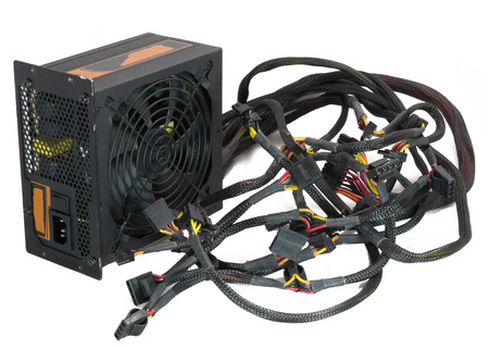 Computer high power supply for gaming and cryptocurrency mining on insulated white background. Фото со стока