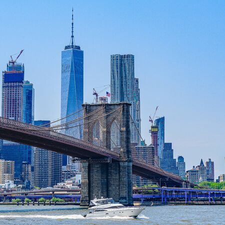 Brooklyn Bridge with lower Manhattan skyline, One World Trade Center in New York City.