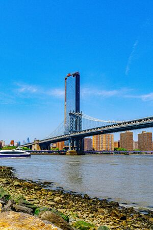 Manhattan Bridge over East River and waterfront condominium Manhattan New York City Фото со стока